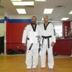 Master Hook presenting me with Black Belt certificate.