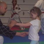 Master Hook teaching Mila